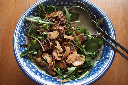 Wilted Dandelion Salad with Crispy Onions and Garlic